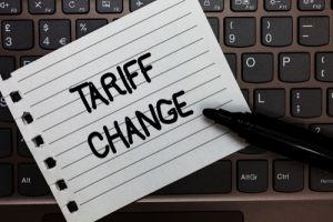 Tariff change written on note on top of keyboard
