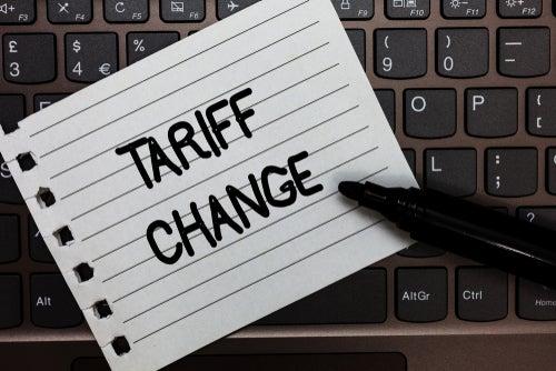 Energy tariff change written on notepad on top of keyboard