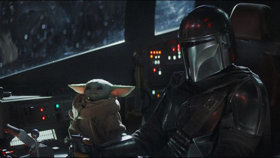 Still from The Mandalorian show of Baby Yoda and The Mandalorian in ship