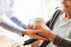 nurse giving woman a tea
