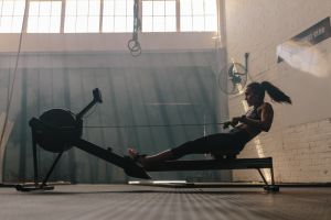 Woman exercising on rowing machine