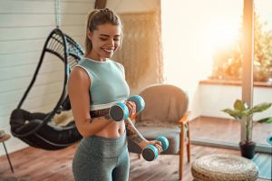 Woman lifting weights at home