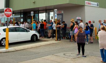 Why you'll need to queue outside Woolies and Coles