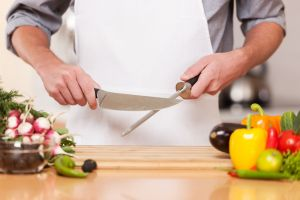 Sharpening knife in kitchen