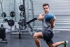 Man exercising medicine ball
