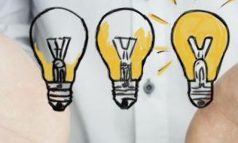 three light bulbs with hands