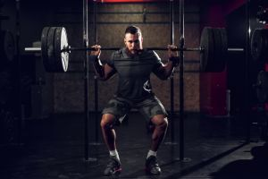 Man using squat rack