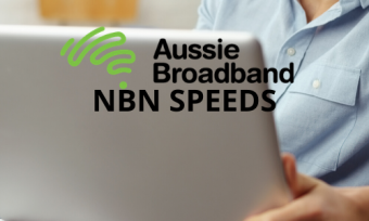 A person using a laptop with the Aussie Broadband logo