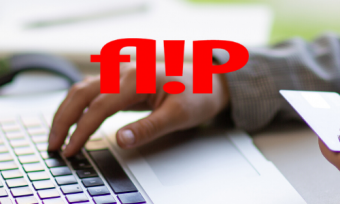 A person using a laptop behind the FLIP logo