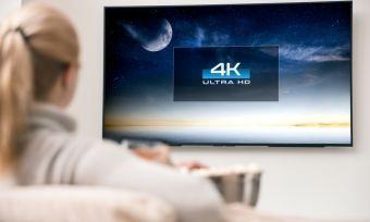 Woman watching 4K TV