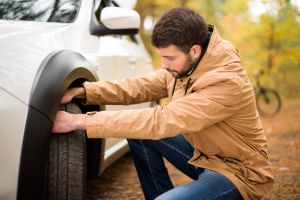 Man checking tyre pressure