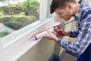Man fixing window seal