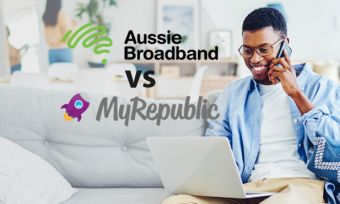 Young man on phone and laptop at home with Aussie Broadband and MyRepublic logos