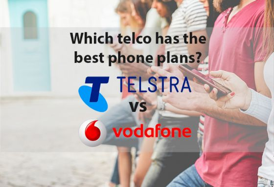 People against wall looking at smartphones with Telstra and Vodafone logos