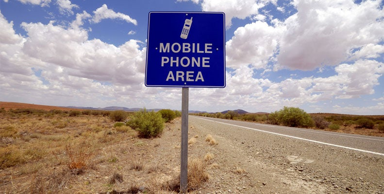 Mobile phone area sign on Australian outback road