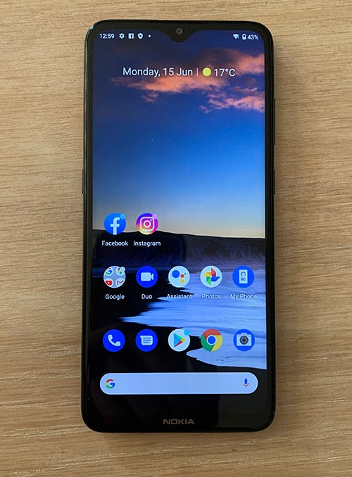 Front of Nokia 5.3 showing phone display