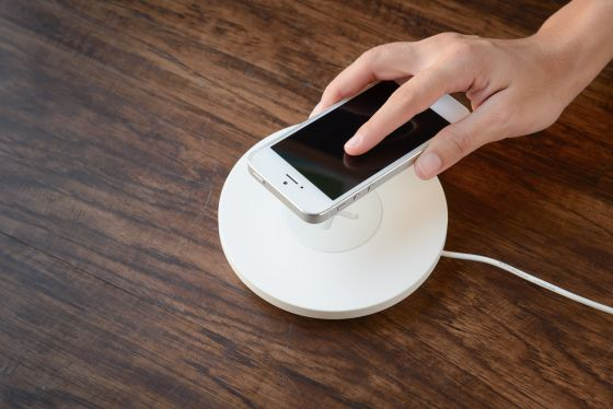 A phone being put on a wireless charger