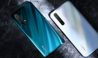 realme X3 SuperZoom phones in white and blue against dark background
