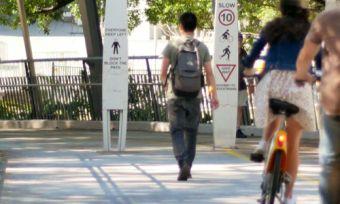 man-walks-bike-path