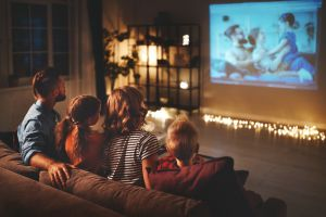 Family watching movie on projector