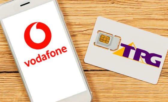 Phone with Vodafone logo and SIM card with TPG logo