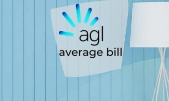 Light blue wall with lamp and agl logo in foreground