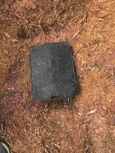 residential water meter box in the ground