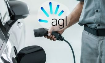 Man charging electric vehicle with AGL logo