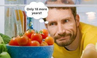 Man looking into fridge