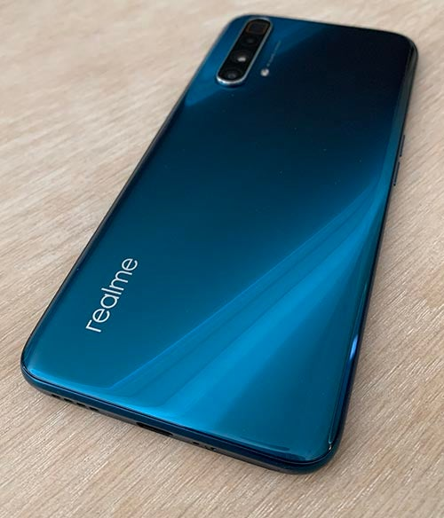 Back of the realme X3 superzoom on wood tabletop