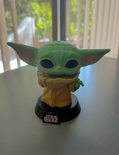 Baby Yoda figurine on tabletop