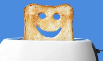 Toast popping out of toaster happy