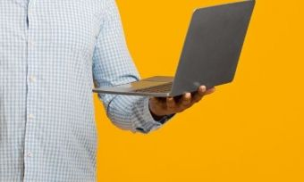 A man holding a laptop