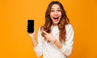 Young woman happy with great mobile deal