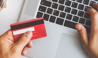 Man online shopping with red credit card