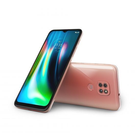 Two pink Motorola Moto G9 phones, the front and back of two, leaning against eachother