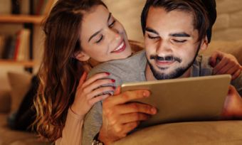 Couple watching tablet together