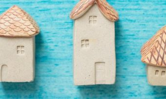 House figurines on blue background