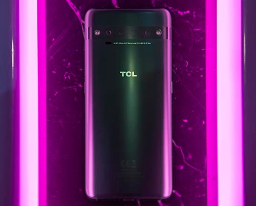 TCL 10 Pro in grey colourway next to purple lights