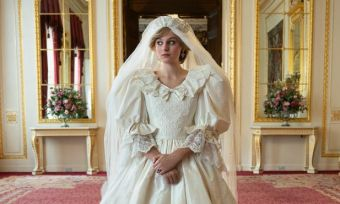 Still of Emma Corrin as Diana Spencer in wedding dress from season 4 of The Crown