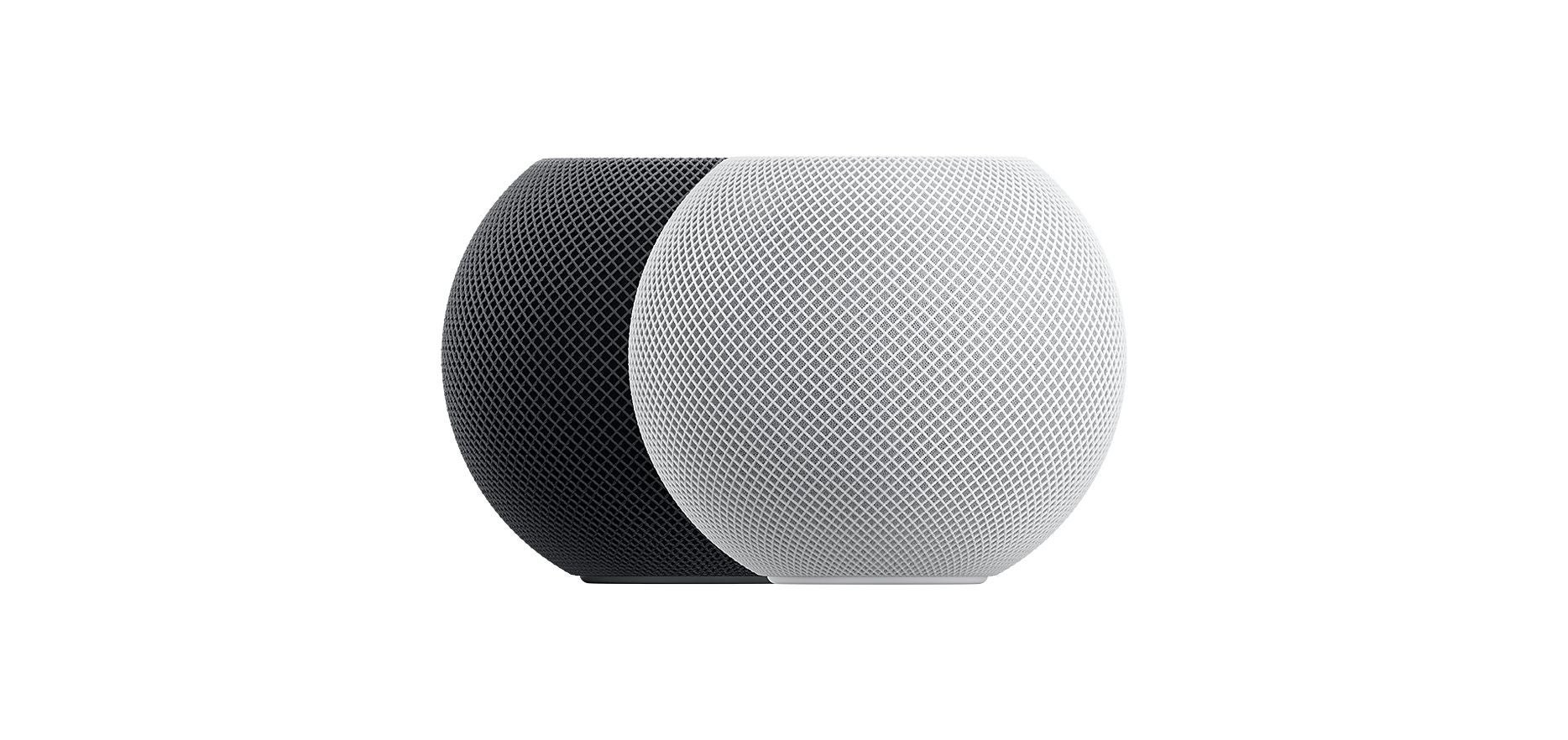 Two Apple HomePod mini's - one in grey and one in white
