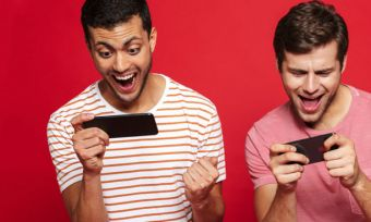 Two men looking at phones cheering