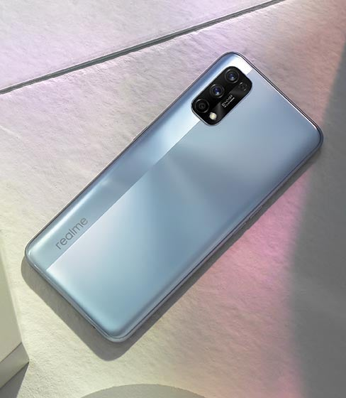 Realme 7 Pro in silver against white tile background