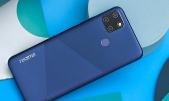 Realme C12 smartphone in blue colour against background with various blue shapes