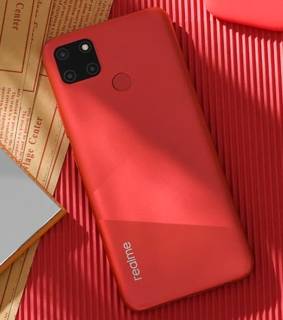 Realme C12 phone in red colou against red textured background