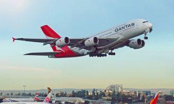 Qantas airplane flying over Sydney