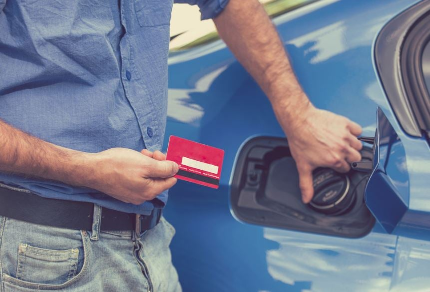 Red fuel card and blue car