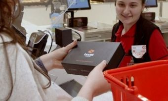 A woman buying an iPhone from Coles