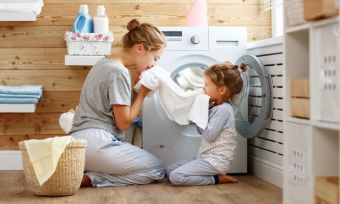 Family using washing machine