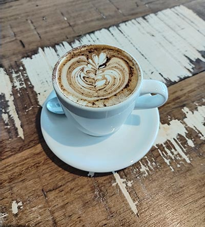 Coffee in mug on wooden table